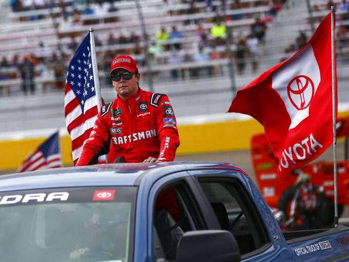 Erik Jones looks on before a NASCAR Cup Series auto race at the Las Vegas Motor Speedway on Sunday, Sept. 15, 2019. (AP Photo/Chase Stevens)