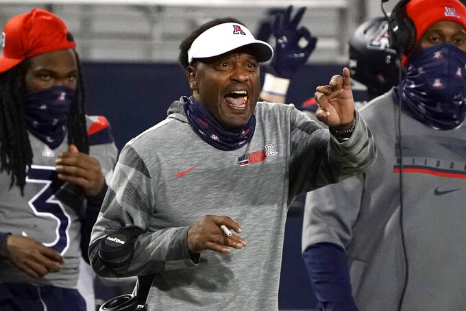 FILE - In this Saturday, Dec. 5, 2020, file photo, Arizona head coach Kevin Sumlin reacts to a call in the second half of an NCAA college football game against Colorado,, in Tucson, Ariz. Sumlin was fired Saturday, Dec. 12, 2020, less than 24 hours after a 70-7 loss to Arizona State that stretched the Wildcats' losing streak to 12 games spanning two seasons.   (AP Photo/Rick Scuteri, File)