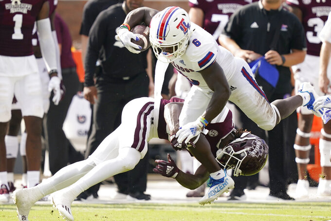 Louisiana Tech wide receiver Smoke Harris (6) is knocked off his feet by Mississippi State's Jaden Walley (11) during the first half of an NCAA college football game in Starkville, Miss., Saturday, Sept. 4, 2021. (AP Photo/Rogelio V. Solis)
