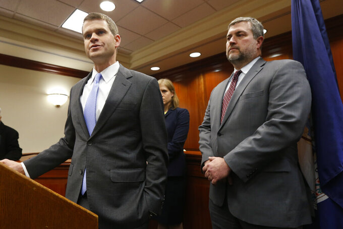 U.S. Attorney Thomas Cullen, left, speaks to the media along with FBI agent James Dwyer, right, after a plea agreement with James Alex Fields who was charged with 30 counts stemming from a car attack during the Unite the Right rally in 2017, in federal court in Charlottesville, Va., Wednesday, March 27, 2019. (AP Photo/Steve Helber)