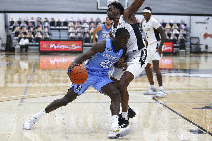 Creighton's Damien Jefferson (23) is defended by Providence's Jimmy Nichols, Jr. (5) during the second half of an NCAA college basketball game Saturday, Jan. 2, 2021, in Providence, R.I. (AP Photo/Stew Milne)