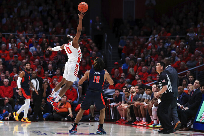 Dayton's Zimi Nwokeji (0) leaps as he knocks the ball out of bounds against Duquesne's Sincere Carry (10) in the first half of an NCAA college basketball game, Saturday, Feb. 22, 2020, in Dayton, Ohio. (AP Photo/Aaron Doster)