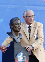 Former NFL player Johnny Robinson poses with his Pro Football Hall of Fame bust during inductions at the hall Saturday, Aug. 3, 2019, in Canton, Ohio. (AP Photo/Ron Schwane)