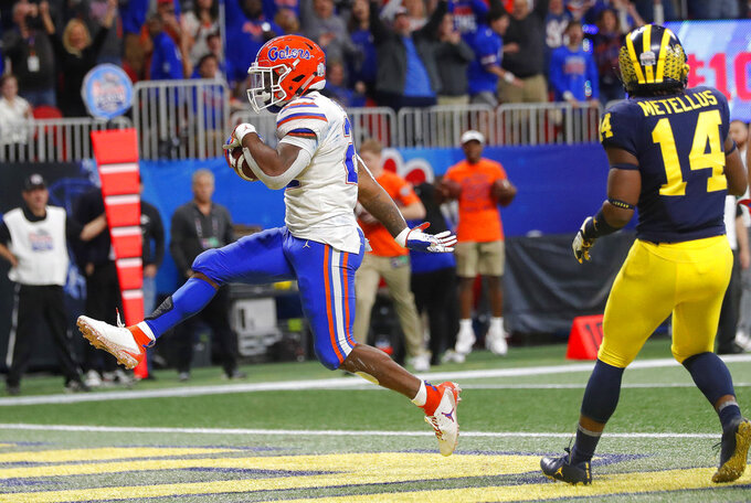 Florida running back Lamical Perine (22) runs into the end zone for a touchdown against Michigan during the first half of the Peach Bowl NCAA college football game, Saturday, Dec. 29, 2018, in Atlanta. (AP Photo/John Bazemore)