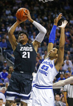 Gonzaga forward Rui Hachimura (21) goes to the basket as BYU forward Yoeli Childs (23) defends during the first half of an NCAA college basketball game Thursday, Jan. 31, 2019, in Provo, Utah. (AP Photo/Rick Bowmer)
