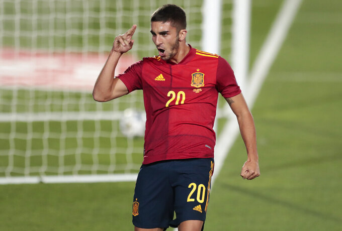 FILE - In this Sunday, Sept. 6, 2020 file photo, Spain's Ferran Torres celebrates after scoring his team's fourth goal during the UEFA Nations League soccer match between Spain and Ukraine at the Estadio Alfredo Di Stefano stadium in Madrid, Spain. Exciting talents like Phil Foden, Joao Felix and Ferran Torres are among a host of young players set to play their first major international tournaments at Euro 2020. UEFA has expanded squads from 23 players to 26 and that could encourage coaches to take a chance on more up-and-comers. (AP Photo/Bernat Armangue, File)