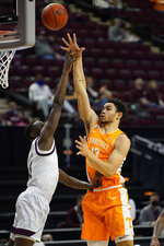 Tennessee forward Olivier Nkamhoua (13) gets a shot over Texas A&M guard Hassan Diarra (11) during the second half of an NCAA college basketball game Saturday, Jan. 9, 2021, in College Station, Texas. (AP Photo/Sam Craft)