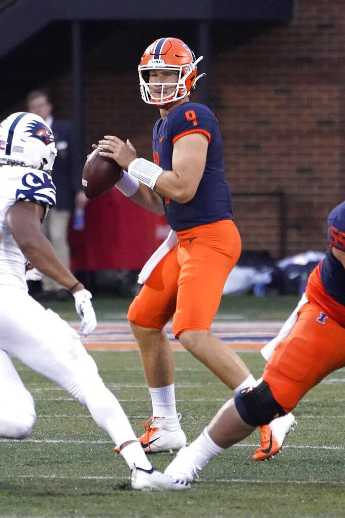 Illinois quarterback Artur Sitkowski looks to pass during the first half of an NCAA college football game against UTSA, Saturday, Sept. 4, 2021, in Champaign, Ill. (AP Photo/Charles Rex Arbogast)