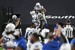 Indianapolis Colts running back Jonathan Taylor (28) celebrates after scoring a touchdown against the Las Vegas Raiders during the second half of an NFL football game, Sunday, Dec. 13, 2020, in Las Vegas. (AP Photo/David Becker)