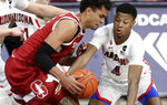 Arizona guard Dalen Terry (4) swipes the ball from Stanford forward Oscar da Silva during the second half of an NCAA college basketball game in Tucson, Ariz., Thursday, Jan. 28, 2021. (Kelly Presnell/Arizona Daily Star via AP)