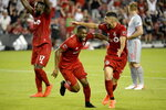 Toronto FC defender Ashtone Morgan (5) celebrates his goal with teammate Jonathan Osorio (21) during the second half of an MLS soccer match against the New York Red Bulls on Wednesday, July 17, 2019, in Toronto. (Nathan Denette/The Canadian Press via AP)