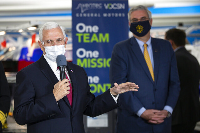 Vice President Mike Pence speaks during a visit to the General Motors/Ventec ventilator production facility with Indiana Gov. Eric Holcomb in Kokomo, Ind., Thursday, April 30, 2020. (AP Photo/Michael Conroy)