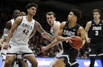 Gonzaga's Ryan Woolridge, second from right, drives against St. Mary's Dan Fotu (42) and Tanner Krebs in the first half of an NCAA college basketball game Saturday, Feb. 8, 2020, in Moraga, Calif. (AP Photo/Ben Margot)