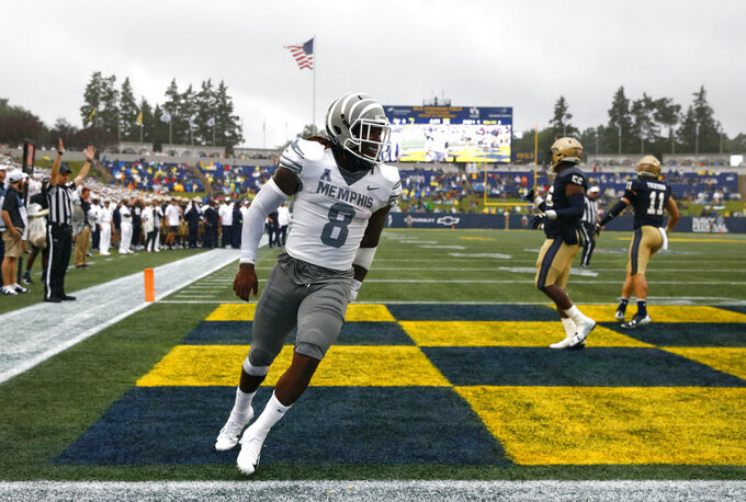 Navy uses fourth-quarter rally to beat Memphis 22-21 in rain