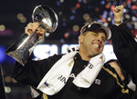 FILE - In this Feb. 7, 2010, file photo, New Orleans Saints head coach Sean Payton celebrates with the Vince Lombardi Trophy after the Saints' 31-17 win over the Indianapolis Colts in the NFL Super Bowl XLIV football game, in Miami. Sean Payton risked everything to start the second half of Super Bowl 44. The New Orleans Saints made sure his big bet paid off. (AP Photo/Julie Jacobson, File)