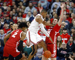 Ohio State forward Kaleb Wesson, center, loses the ball between Wisconsin forwards Aleem Ford, left, and Nate Reuvers during the first half of an NCAA college basketball game in Columbus, Ohio, Friday, Jan. 3, 2020. (AP Photo/Paul Vernon)