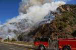 Firefighters arrive on scene of the Palisades Fire in the Pacific Palisades area of Los Angeles Monday, Oct. 21, 2019. (AP Photo/Christian Monterrosa)