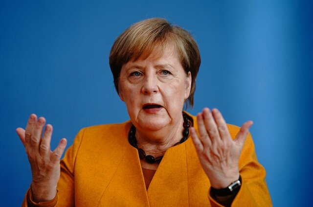 German Chancellor Angela Merkel (CDU) gives a press conference to capital city journalists at the Federal Press Conference in Berlin, Monday, Nov.2, 2020. The Chancellor will inform media representatives about the results of the corona cabinet on corona measures and the current situation of the infection incidence. (Kay Nietfeld/dpa via AP)