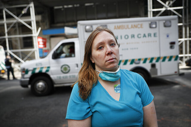 Registered Nurse Elizabeth Schafer, 36, of South St. Paul, Minn., stands for a portrait before entering Beth Israel Mount Sinai Hospital for her second day volunteering to combat the COVID-19 pandemic, Wednesday, April 1, 2020, in New York. Schafer left her home in the Midwest to volunteer in New York where she says the situation inside the hospital is grim.