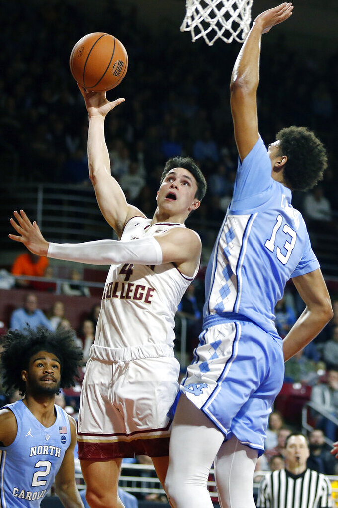 Boston College's Chris Herren Jr. (4) shoots against North Carolina's Cameron Johnson (13) during the first half of an NCAA college basketball game in Boston, Tuesday, March 5, 2019. (AP Photo/Michael Dwyer)