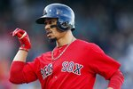 Boston Red Sox's Mookie Betts reacts after his RBI single during the third inning of a baseball game against the Baltimore Orioles in Boston, Sunday, Sept. 29, 2019. (AP Photo/Michael Dwyer)