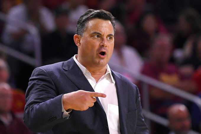 Arizona head coach Sean Miller gestures to his team during the first half of an NCAA college basketball game against Southern California Thursday, Feb. 27, 2020, in Los Angeles. (AP Photo/Mark J. Terrill)