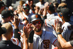 San Francisco Giants' Evan Longoria is welcomed in the dugout followed by Kevin Pillar after they scored on a double to centerfield by Joey Rickard during the sixth inning of a baseball game against the Atlanta Braves, Sunday, Sept. 22, 2019, in Atlanta. The Giants won 4-1. (AP Photo/John Amis)