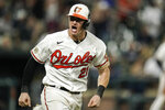 Baltimore Orioles' Austin Hays shouts toward his dugout as he runs after hitting a two-run home run off New York Yankees relief pitcher Chad Green during the eighth inning of a baseball game, Wednesday, Sept. 15, 2021, in Baltimore. (AP Photo/Julio Cortez)