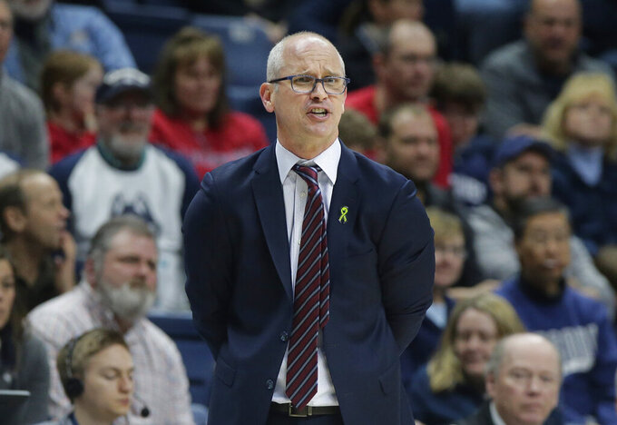 FILE - In this March 3, 2019, file photo, Connecticut head coach Dan Hurley shouts from the bench during the second half of an NCAA college basketball game against South Florida, in Storrs, Conn. Hurley expects UConn to be better this season, the second in the coach's effort to rebuild the storied program back to national prominence. That doesn't mean that Connecticut, which went 16-17 a year ago, will compete for a fifth national championship, but it should mean the Huskies will win more games than they lose. That's something UConn has not done since 2015-16. (AP Photo/Steven Senne, File)