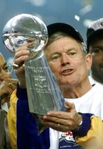 File-This Jan. 30, 2000, file photo shows St. Louis Rams coach Dick Vermeil holding the Vince Lombardi trophy after the team's 23-16 victory over the Tennessee Titans in Super Bowl XXIV in Atlanta. The Greatest Show On Turf. Yes, at the turn of the century, there was a group that shared so many light-em-up traits with these Rams and Patriots. The St. Louis Rams under of all people,  Vermeil, for decades a defense-minded coach, employed a quick-strike scheme with a resourceful quarterback, game-breaking receivers, a Hall of Fame running back  and an offensive line that could dominate while blocking in the ground game or protecting the passer. (AP Photo/Rusty Kennedy, File)