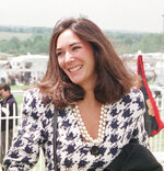 FILE - In this June 5, 1991 file photo, British socialite Ghislaine Maxwell arrives at Epsom Racecourse. The FBI said Thursday July 2, 2020, Ghislaine Maxwell, who was accused by many women of helping procure underage sex partners for Jeffrey Epstein, has been arrested in New Hampshire. (Chris Ison/PA via AP, File)