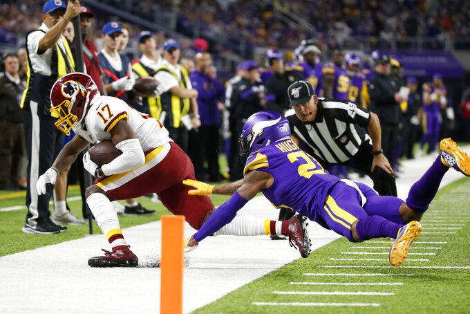Washington Redskins wide receiver Terry McLaurin (17) is forced out of bounds by Minnesota Vikings cornerback Mike Hughes, right, after catching a pass during the first half of an NFL football game, Thursday, Oct. 24, 2019, in Minneapolis. (AP Photo/Bruce Kluckhohn)