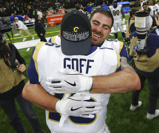 Los Angeles Rams' Jared Goff celebrates with Tyler Higbee after a game-winning field goal during overtime of the NFL football NFC championship game against the New Orleans Saints Sunday, Jan. 20, 2019, in New Orleans. The Rams won 26-23. (AP Photo/Gerald Herbert)