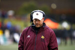 Texas State head coach Jake Spavital walks the sidelines during the first half of an NCAA college football game against Appalachian State Saturday, Nov. 23, 2019, in Boone, N.C. (AP Photo/Brian Blanco)