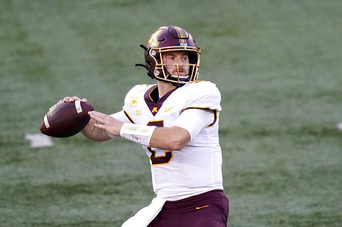 Minnesota quarterback Tanner Morgan drops back to throw during the first half of an NCAA college football game against Illinois Saturday, Nov. 7, 2020, in Champaign, Ill. (AP Photo/Charles Rex Arbogast)