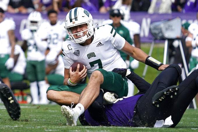 Ohio quarterback Kurtis Rourke, top, is sacked by Northwestern linebacker Khalid Jones during the second half of an NCAA college football game in Evanston, Ill., Saturday, Sept. 25, 2021. Northwestern won 35-6. (AP Photo/Nam Y. Huh)