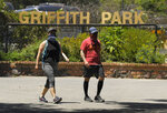 Hikers one of the trails near Griffith Park, Thursday, May 28, 2020, in Los Angeles. Several parks and trails have recently reopened in the city during the coronavirus pandemic. (AP Photo/Mark J. Terrill)