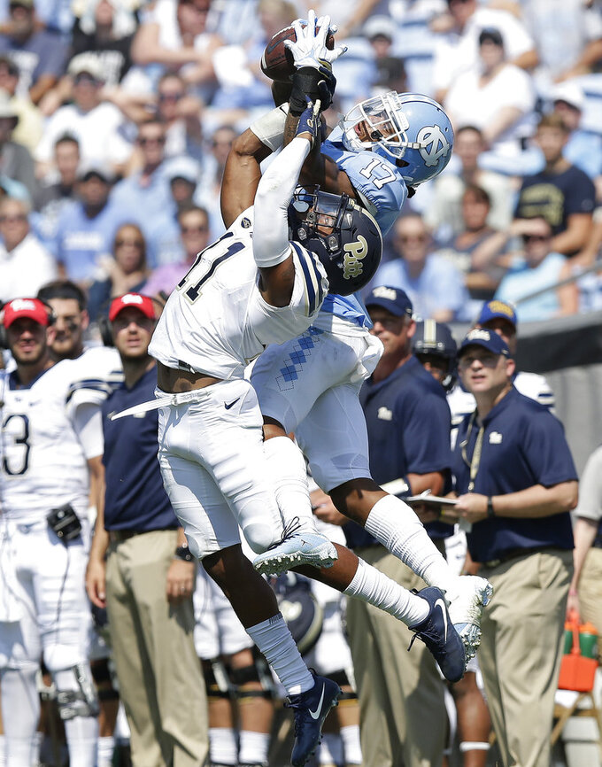 North Carolina's Anthony Ratliff-Williams (17) catches a pass while Pittsburgh's Dane Jackson (11) defends during the first half of an NCAA college football game in Chapel Hill, N.C., Saturday, Sept. 22, 2018. (AP Photo/Gerry Broome)