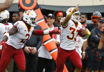 Iowa State defensive back Braxton Lewis (33) celebrates with teammate Willie Harvey (2) after an interception in the second half of an NCAA college football game against Oklahoma State in Stillwater, Okla., Saturday, Oct. 6, 2018. (AP Photo/Sue Ogrocki)