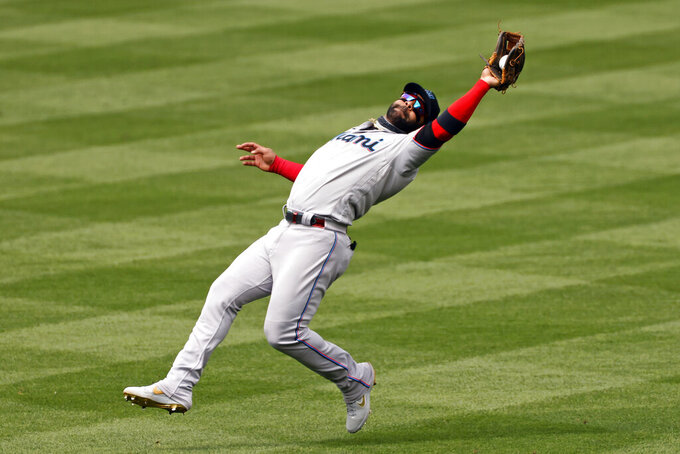 Miami Marlins second baseman Jonathan Villar makes an out on New York Mets' Wilson Ramos during the fifth inning of a baseball game on Monday, August 31,2020, in New York. (AP Photo/Adam Hunger)