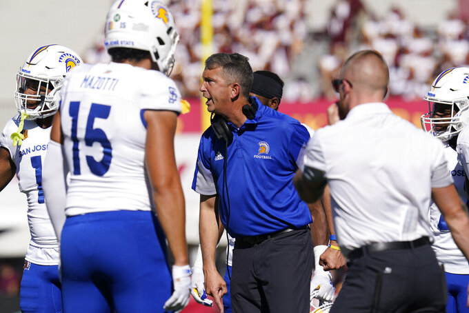 San Jose State head coach Brent Brennan, center, yells from the sideline during an NCAA college football game against Southern California Saturday, Sept. 4, 2021, in Los Angeles. (AP Photo/Ashley Landis)