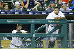 Detroit Tigers' Jordy Mercer, left, and Harold Castro watch from the dugout during the ninth inning of a 7-5 loss to the Toronto Blue Jays in a baseball game, Saturday, July 20, 2019, in Detroit. (AP Photo/Duane Burleson)