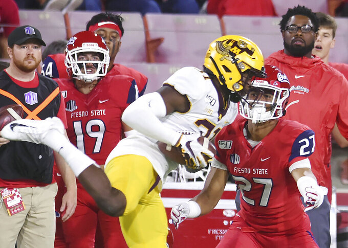 Minnesota's Kiondre Thomas, left, intercepts a pass intended for Fresno State's Zane Pope, right, during an NCAA college football game Saturday, Sept. 7, 2019, in Fresno, Calif. (Eric Paul Zamora/The Bee via AP)