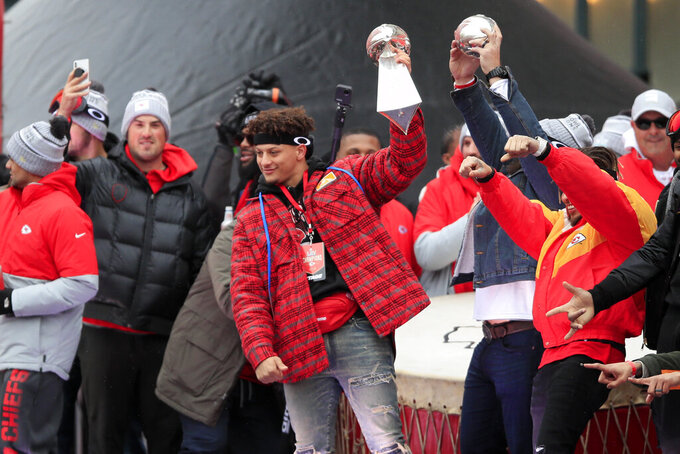 Kansas City Chiefs quarterback Patrick Mahomes holds the Super Bowl trophy during a rally in Kansas City, Mo., Wednesday, Feb. 5, 2020. (AP Photo/Orlin Wagner)