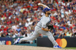 National League pitcher Clayton Kershaw, of the Los Angeles Dodgers, throws during the second inning of the MLB baseball All-Star Game against the American League, Tuesday, July 9, 2019, in Cleveland. (AP Photo/John Minchillo)