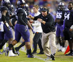FILE - In this Nov. 24, 2018, file photo, TCU head coach Gary Patterson yells at one of his players during the second quarter of an NCAA college football game against Oklahoma State in Fort Worth, Texas. California, TCU looking to close out 2018 season on a high note at Cheez-It Bowl on Dec. 26, after struggling to gain bowl eligibility. (Tom Fox/The Dallas Morning News via AP, File)
