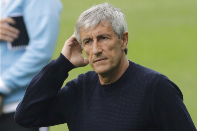 Barcelona's head coach Quique Setien gestures after the Spanish La Liga soccer match between RC Celta and Barcelona at the Balaidos stadium in Vigo, Spain, Saturday, June 27, 2020. (AP Photo/Lalo Villar)