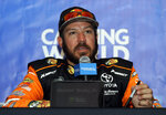 Martin Truex Jr., talks to media during a practice for the NASCAR Sprint Cup Series auto race at Chicagoland Speedway in Joliet, Ill., Saturday, June 29, 2018. (AP Photo/Nam Y. Huh)