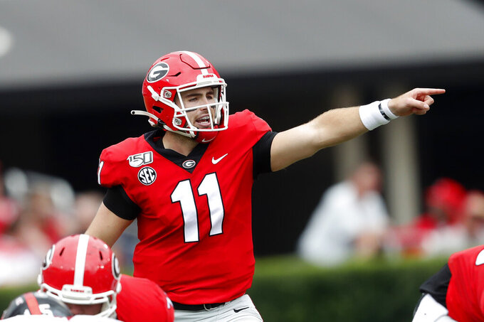 "FILE - In this Sept. 14, 2019, file photo, Georgia quarterback Jake Fromm (11) is shown In the first half of an NCAA college football game against Arkansas State, in Athens, Ga. Fromm says Jim Chaney, the Bulldogs' former offensive coordinator, ""really kind of introduced me to this pro-style offense."" Now Chaney is running Tennessee's offense, and Fromm wants to show he learned his lessons well when the No. 3 Bulldogs face the Vols on Saturday. (AP Photo/John Bazemore, File)"
