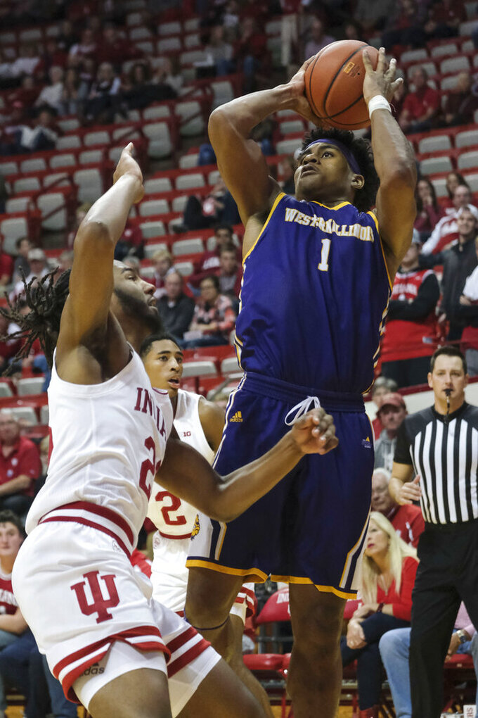 Western Illinois guard Zion Young, right, shoots over Indiana forward Damezi Anderson in the second half of an NCAA college basketball game in Bloomington, Ind., Tuesday, Nov. 5, 2019. Indiana won 98-65. (AP Photo/AJ Mast)